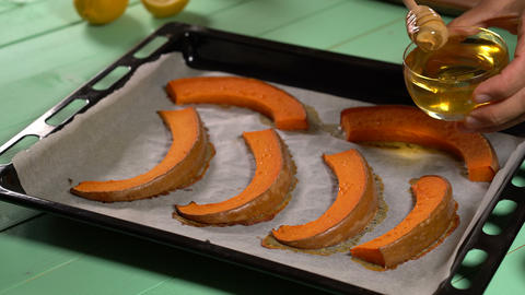 Chef pours honey on the baked pumpkin slices Footage