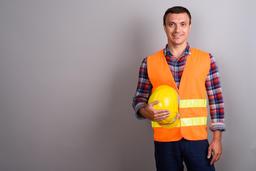 Man construction worker against gray background Fotografía