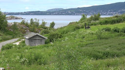 North Europe Norway Saltstraumen wooden shed in dreamlike nature of fjord Footage