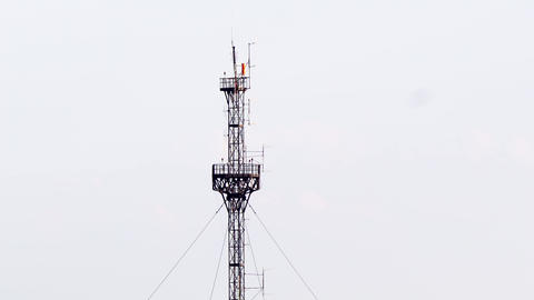 Telecommunication tower against blue sky Footage