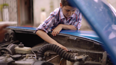 6-Boy Fixing Car Engine Gives Five To Grandpa Footage