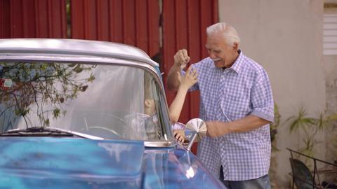 7-Senior Man Grandfather Giving Car Keys To Boy Footage
