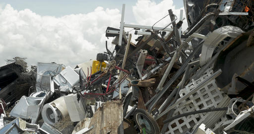 Large pile of scrap metal consumer and household trash at a recycling center, Footage