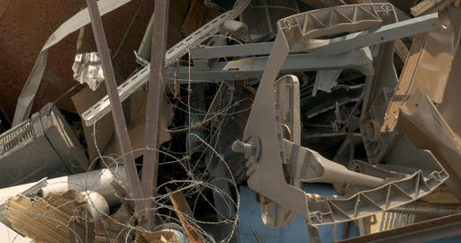 Barbed wire, steel, and plastic trash piled up in a recycling center, junkyard, Footage