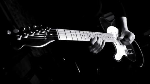 Guitarist Playing Guitar in the Music Studio Archivo