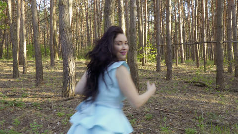Beautiful woman in blue dress running in the forest, Snow White fairytale Footage