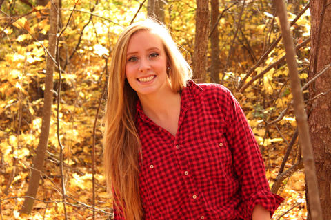 Beautiful Blonde Girl in Plaid in Fall Foliage Photo