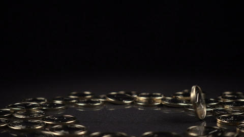 one euro coin spinning on a black background Footage