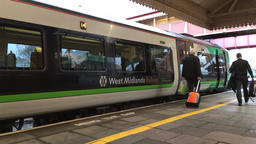 Train drivers boarding the drivers cab on a West Midlands Railway train UK Footage