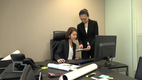 Business Women Meeting In Office And Using Ipad Digital Tablet Live Action