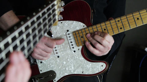 Guitarist and Bassist Rehearsing in the Music Studio Archivo