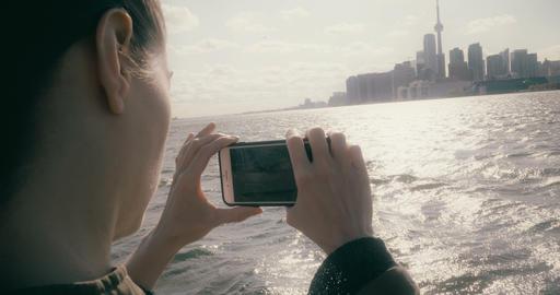 Woman taking video of the Toronto skyline Footage