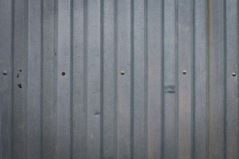 Background of an iron fence with screws フォト