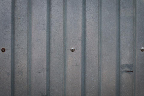 Background of an iron fence with screws Fotografía