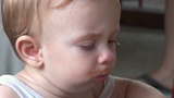 HD - Funny Baby All Messed Up From Lunch Caughing stock footage