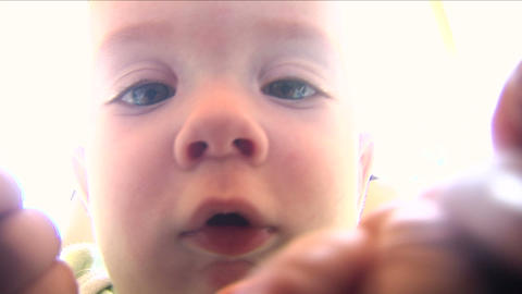 Baby playing with camera 02 Footage