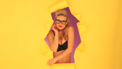 Sexy Blonde Woman Looking Through A Hole stock footage