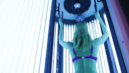 Beautiful girl in swimsuit at solarium Footage