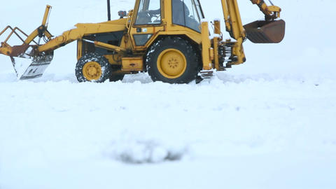Yellow dredger shovels snow away Footage