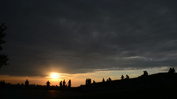 Sunset and Silhouette People on a mountain Footage