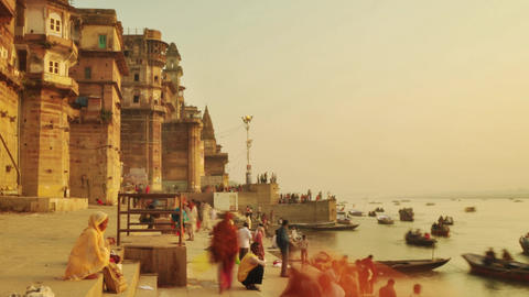 Time lapse Indian pilgrims rowing boat in sunrise. Ganges river at Varanasi Footage