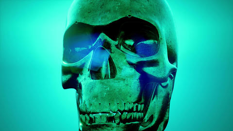 metall skull rotate on colored background Archivo