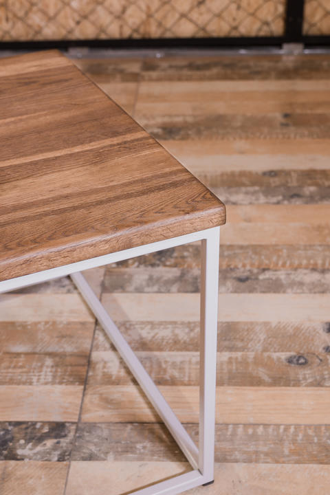 Bedside wooden table in loft style in a room of wood Photo