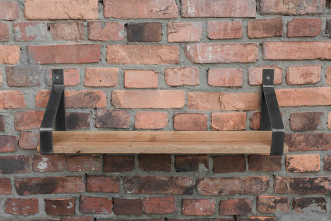 Shelf in wood and metal hanging on a brick wall in loft style Photo
