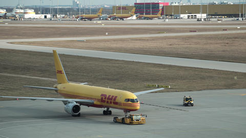 DHL Plane Being Taxied Handheld Wide Archivo
