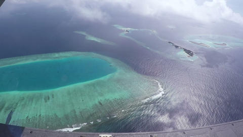 Aerial View From Airplane Window On Maldivian Islands. With Parts Of The Plane ビデオ