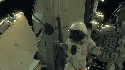 Astronaut working on the ISS. Realistic 4K animation Live Action