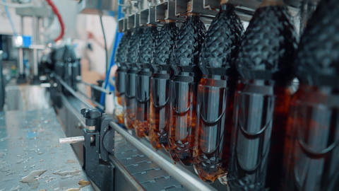 The production line of carbonated beverages. Water and soda in bottles are GIF