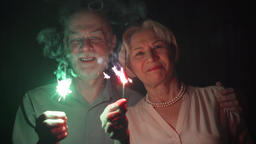 Slow Motion. Senior couple with sparklers celebrating Christmas. Happy family Footage