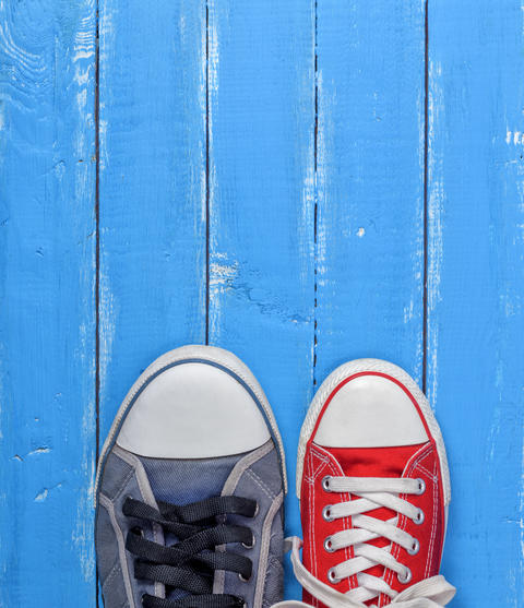 pair of textile worn gumshoes, red and blue sneakers Photo