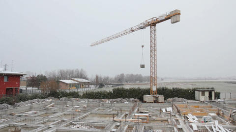 Crane on construction site stopped during a snowfall 영상물