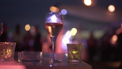 Drink glasses in bar GIF