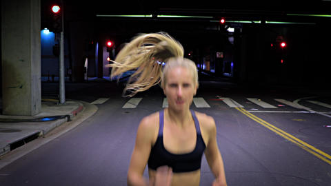 Attractive Woman Jogging Through A Tunnel Footage