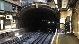 London Underground train entering Victoria station London UK 影片素材