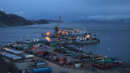 Evening view of crab processing ship, fishing trawlers at pier in seaport Footage