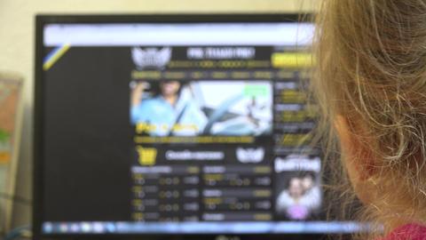 Little Girl Searching in Internet on PC. 4K UltraHD, UHD Footage