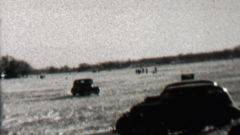 1939: Car driving on frozen lake sliding drift driving on ice surface Footage