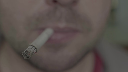 A Man Smokes A Cigarette (close-up) stock footage
