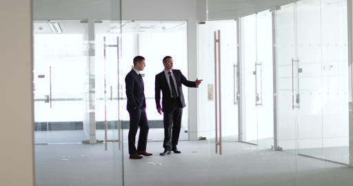 Businessmen looking at new office space Footage