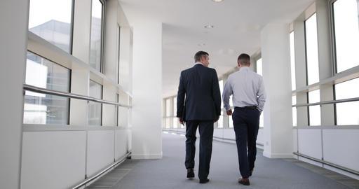 Businessmen walking away from camera ビデオ