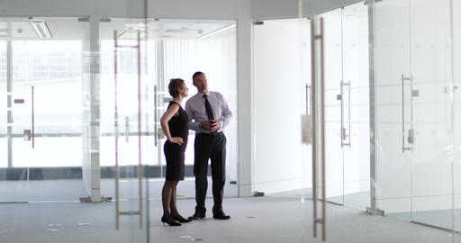 Business colleagues looking at new office space Footage