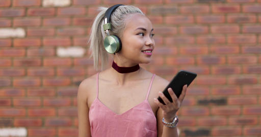 Young adult female streaming music Live Action