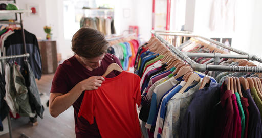 Young adult male clothes shopping ビデオ
