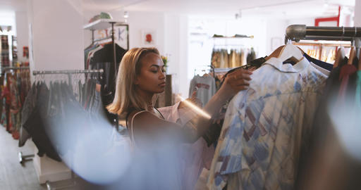 Young adult female clothes shopping Footage