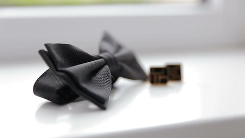 Wedding cufflinks and bow tie close up Footage