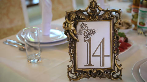 On table is decorated with a festive table number Live Action
